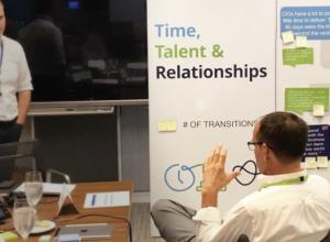 Bo Wandschneider talking to colleague in an office