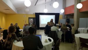 ITS staff sitting at tables talking during IT@UofT strategic plan consultation meeting