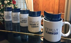 """Image of five different IT@UofT mugs with """"happy holidays"""" card inside"""