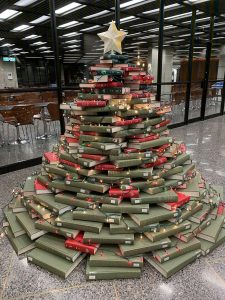A Christmas tree made of a stack of books